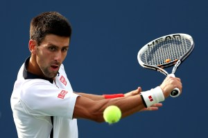 NEW YORK, NY - SEPTEMBER 08:  Novak Djokovic of Serbia returns a shot during his men's singles semifinal match against David Ferrer of Spain on Day Thirteen of the 2012 US Open at USTA Billie Jean King National Tennis Center on September 8, 2012 in the Flushing neighborhood of the Queens borough of New York City.  (Photo by Clive Brunskill/Getty Images)