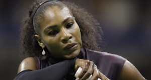 Serena Williams wipes sweat from her face between serves from Karolina Pliskova, of the Czech Republic, during the semifinals of the U.S. Open tennis tournament, Thursday, Sept. 8, 2016, in New York. (AP Photo/Charles Krupa)