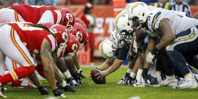 The Kansas City Chiefs defense gets set at the line of scrimmage against the San Diego Chargers offense during an NFL football game on Sunday, Dec. 13, 2015 in Kansas City, Mo. The Chiefs won, 10-3. (G. Newman Lowrance via AP)